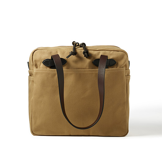 Travel in style - pack your swimwear, toiletries, electronics, what have you - in Filson's original tote bag! Extra durable and resistant so you can trust it in any kind of weather.  Filson Zippered Tote Bag in tan, $159. Available at LoveAllSeasons.com.